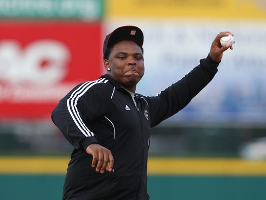 Aquinas grad and Notre Dame lineman Jarron Jones throws out the first pitch at the Red Wings game.