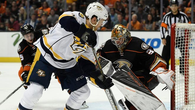 Ducks goalie Frederik Andersen makes a save in front of Predators left wing Colin Wilson during the third period in Game 5 on Saturday at Honda Center.