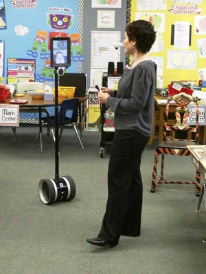 Lincoln-Erdman Elementary second grade teacher Karen Rowan-Lieser interacts with student Joseph Lazarewicz through his robot, dubbed Jobot by classmates. Lazarewicz, recovering from lymphatic cancer at his home, uses the robot to remotely attend class and socialize with classmates.