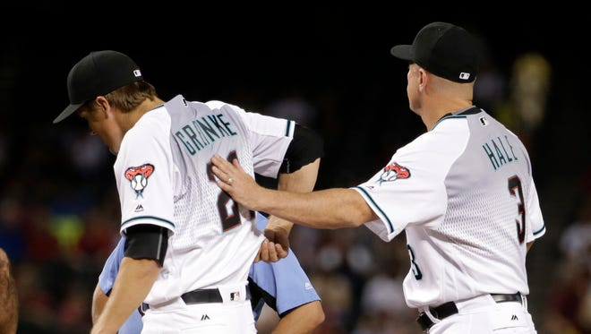 Arizona Diamondbacks manager Chip Hale (3) removes Diamondbacks pitcher Zack Greinke (21) from the game against the Philadelphia Phillies during the third inning of a baseball game, Tuesday, June 28, 2016, in Phoenix.