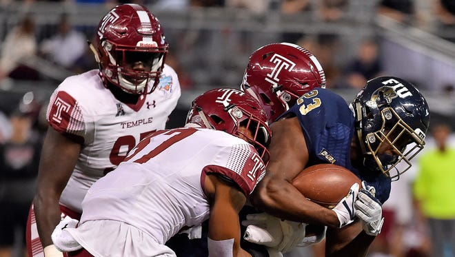 Temple Owls linebacker Isaiah Graham-Mobley (37) tackles FIU Panthers running back Napoleon Maxwell (23) during the first half in the 2017 Gasparilla Bowl at Tropicana Field.