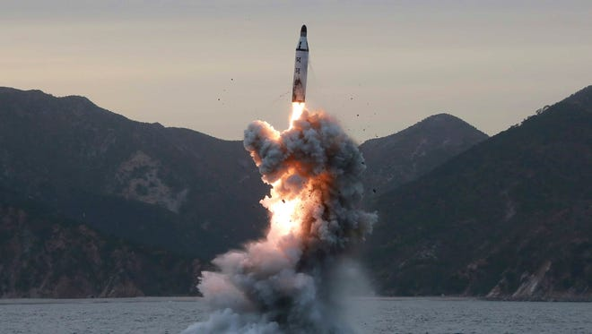 """This undated file photo released by the North Korean Central News Agency (KCNA), the state news agency of North Korea, shows an """"underwater test-fire of strategic submarine ballistic missile"""" conducted at an undisclosed location in North Korea."""