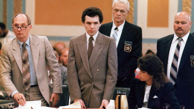 AUGUST. 18, 1987: Former Drake Hospital orderly Donald Harvey (center) and his attorney, William Whalen, (left) stand before Judge William S. Mathews in Hamilton County Common Pleas Court in the Hamilton County Courthouse. A