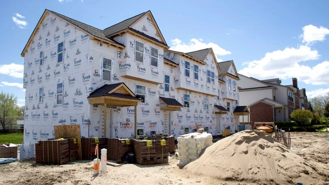 New townhouses under construction in Wixom in May 2017.