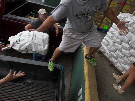 Volunteers from Suncoast Estates fill the back of their