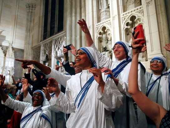 A group of nuns reacts as they await Pope Francis'