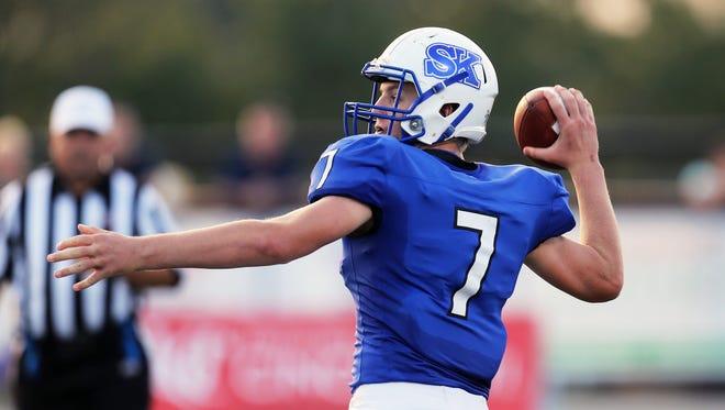 Simon Kenton quarterback Matt Shearer throws this pass for a touchdown in the game between the Highlands Bluebirds and the Simon Kenton Pioneers at Simon Kenton High School in Independence, Kentucky Sept. 22 2017.