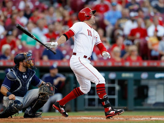 Cincinnati Reds' Joey Votto watches his double off San Diego Padres' Travis Wood during the first inning of a baseball game, Wednesday, Aug. 9, 2017, in Cincinnati. (AP Photo/John Minchillo)