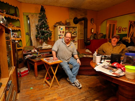 Bob Anderson, 54, and his brother Roy, 70, watch The Bachelor at their farm south of Brighton in Jefferson County Iowa Monday, Jan. 12, 2015.