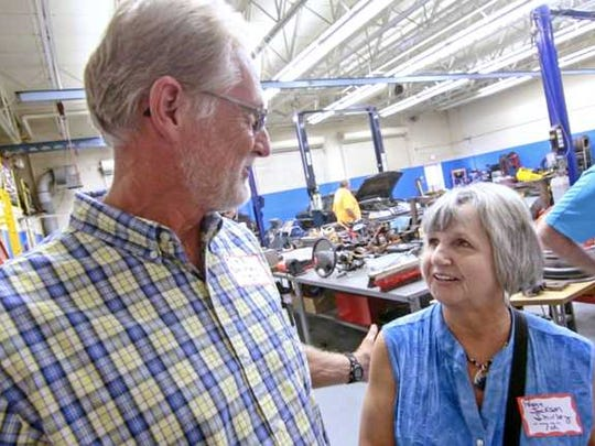 Mike Shirley (class of 1971) and his wife Peggy Shirley (class of 1972) talk about when they met at school during the McDuffie High School reunion of classes Thursday at the school in Anderson.