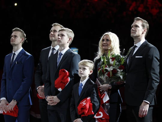 Nicklas Lidstrom with his family Adam, Kevin, Samuel, Lucas and wife Annika as his No. 5 was retired into the Joe Louis Arena rafters in 2014.