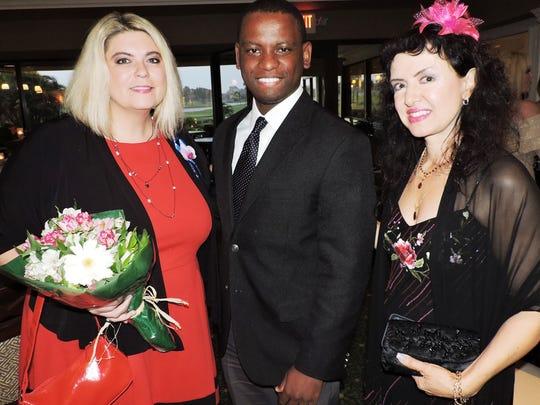 Tara Biek, left, Msebenzi Masondo and Celia Lucente