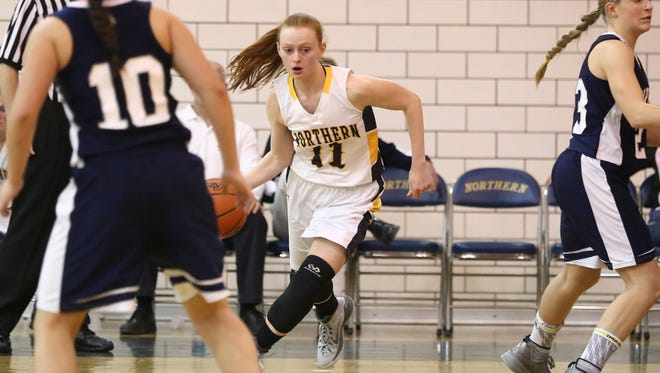 Port Huron Northern junior Kendyl Keyes works the ball toward the basket during a basketball game against Marysville Dec. 22 at Port Huron Northern. Keyes has come back from a torn ACL this summer.