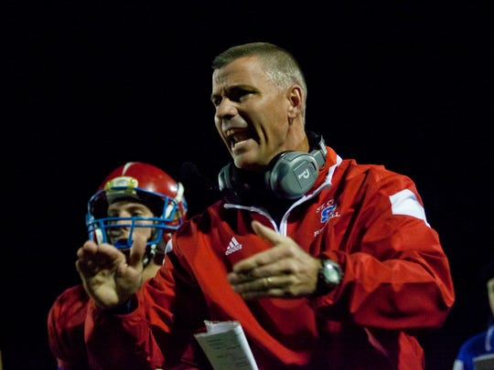 St. Clair coach Bill Nesbitt yells to players from the sidelines during a football game October 3, 2014 at St. Clair High School.