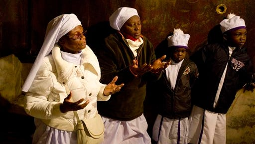 Christian pilgrims from Nigeria pray inside the Grotto of the Church of the Nativity, traditionally believed by Christians to be the birthplace of Jesus Christ, in the West Bank city of Bethlehem on Christmas Eve.