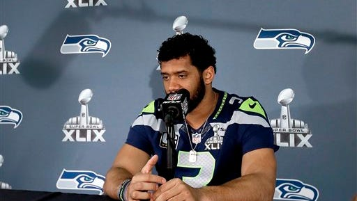 Seattle Seahawks' Russell Wilson waits for a question during an interview for NFL Super Bowl XLIX football game, Thursday, Jan. 29, 2015, in Phoenix. The Seahawks play the New England Patriots in Super Bowl XLIX on Sunday, Feb. 1, 2015.