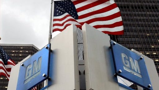 The General Motors logo is seen outside the GM headquarters in downtown
