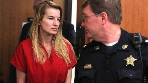 Jody Herring is led out of court after her arraignment  in Vermont Superior Court in Barre, Vt., Monday, Aug. 10, 2015. The Vermont woman charged with killing a social worker because she was upset about losing custody of her 9-year-old daughter pleaded not guilty on Monday and was ordered held without bail.