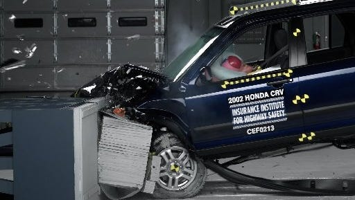 This photo provided by the Insurance Institute for Highway Safety shows a crash test of a 2002 Honda CR-V, one of the models subject to a recall to repair faulty air bags made by Takata Corp.