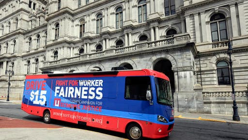 In this Tuesday, March 15, 2016 photo, a recreational vehicle used by New York Gov. Andrew Cuomo in his efforts to raise the minimum wage is parked near the state Capitol in Albany, N.Y.