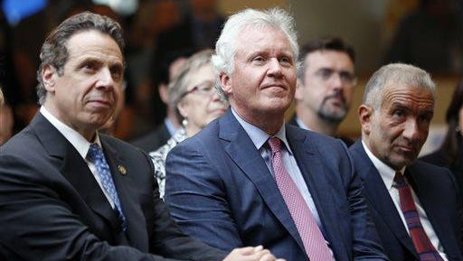 New York Gov. Andrew Cuomo, left, General Electric CEO Jeffrey Immelt, center, and SUNY College of Nanoscale Science and Engineering CEO Alain Kaloyeros listen to a speaker during an economic development news conference at GE Global Research in July 2014.