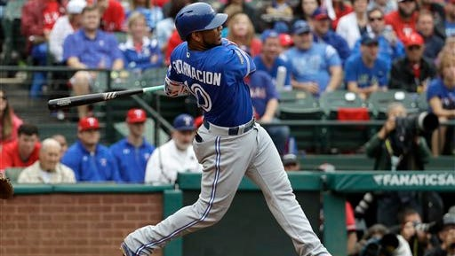 Toronto Blue Jays' Edwin Encarnacion hits a solo home run off of Texas Rangers' Yu Darvish in the fifth inning of Game 2 of baseball's American League Division Series, Friday, Oct. 7, 2016, in Arlington, Texas.
