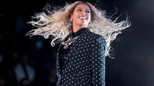 "In this Nov. 4, 2016 file photo, Beyonce performs at a Get Out the Vote concert. Her album ""Lemonade"" just received nine Grammy nods and was considered one of the top music releases in 2016."