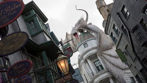 """This June 2014 photo released by Universal Orlando Resort shows """"The Wizarding World of Harry Potter ? Diagon Alley,"""" from the Harry Potter-themed area of Universal Orlando Resort in Orlando, Fla. The attraction, featuring shops, dining experiences and the next generation thrill ride, will officially open on July 8."""