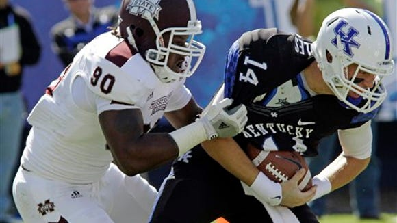 Mississippi State defensive end Denico Autry (90) drags Kentucky quarterback Patrick Towles (14) down from behind for a 10-yard loss late in the first half of an NCAA college football game in Lexington, Ky., Saturday, Oct. 6, 2012.  (AP Photo/Garry Jones)