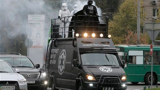 Darth Vader, leader of Ukraine's Internet Party, rides atop a car in Kiev, Ukraine.