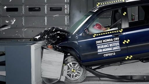 FILE - This undated file photo provided by the Insurance Institute for Highway Safety shows a crash test of a 2002 Honda CR-V, one of the models subject to a recall to repair faulty air bags. Honda on Wednesday, Dec. 3, 2014 said it will expand a recall of cars with Takata driver's side air bags to all 50 states. (AP Photo/Insurance Institute for Highway Safety, File)