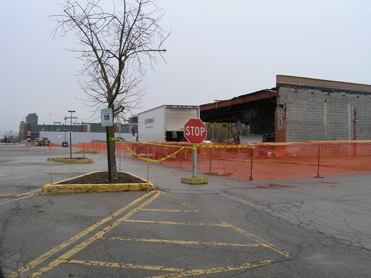 Parking for Green Bay Packers games will remain available on the land they own west of Lambeau Field, where the team is razing unoccupied buildings.