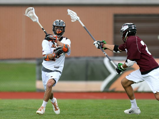 RIT's Kyle Sterzin (2) looks to make a move near the goal in the Liberty League semifinals against Union.