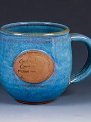 Potter Peter Jones created around 100 of these mugs celebrating Carlsbad Caverns and the centennial year of the National Park Service.