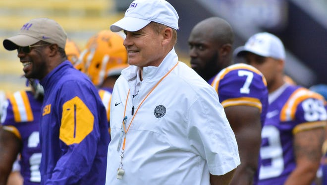 LSU Tigers head coach Les Miles watches player warmups  before the Spring Game at Tiger Stadium.