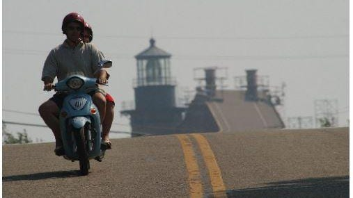 A moped rider on Block Island.