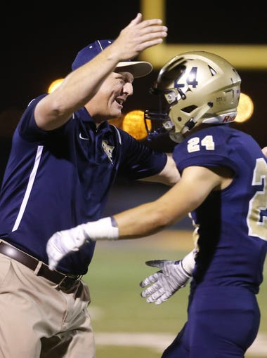 Benjamin Franklin's head coach football Dave Jefferies celebrates with Benjamin Franklin's Zach Jefferies (24) after a touchdown against Florence at Benjamin Franklin in Queen Creek on October 20, 2017.