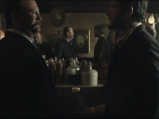This photo provided by Budweiser shows a scene from the company's spot for Super Bowl 51, between the New England Patriots and Atlanta Falcons, Sunday, Feb. 5, 2017. The scene depicts when Anheuser-Busch co-founder Adolphus Busch, right, after traveling by boat from Germany, met fellow immigrant Eberhard Anheuser.
