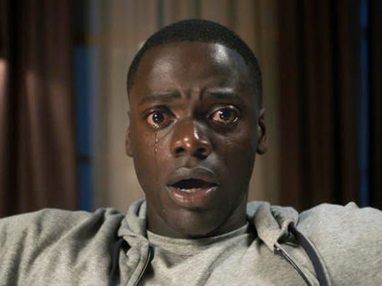 """This image released by Universal Pictures shows Daniel Kaluuya in a scene from, """"Get Out."""""""