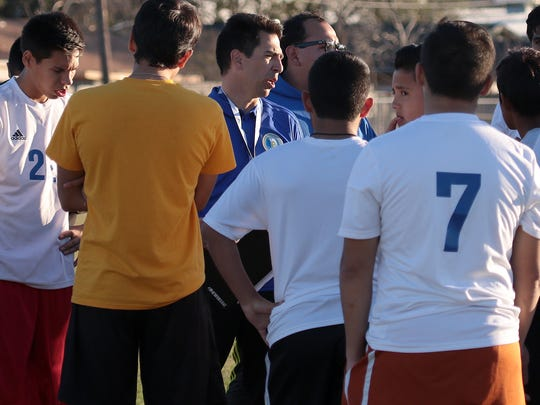 Moody boys soccer coach Jason James (center) is trying to get the Trojans back on track in his second season.