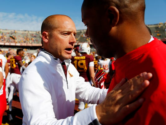 Minnesota P.J. Fleck, left, congratulates a Maryland coach after an NCAA college football game on Saturday, Sept. 30, 2017, in Minneapolis. Maryland defeated Minnesota 31-24.(AP Photo/Andy Clayton-King)