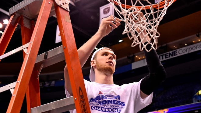 Northern Iowa Panthers forward Seth Tuttle (10) cuts a piece of the net after defeating the Illinois State Redbirds in the championship game of the Missouri Valley Conference basketball tournament at Scotttrade Center. The Panthers won 60-69.