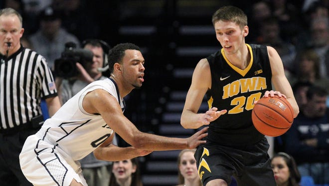 Penn State Nittany Lions forward Payton Banks (0) defends Iowa Hawkeyes forward Jarrod Uthoff (20) during the first half at Bryce Jordan Center.