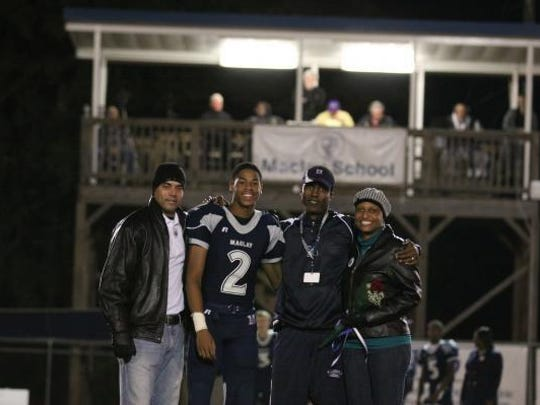 Maclay's Seth Roberts poses for a photo on Senior Night with father Ronnie Roberts (far left), Marauders coach Kez McCorvey, and mother Jill Roberts (far right).