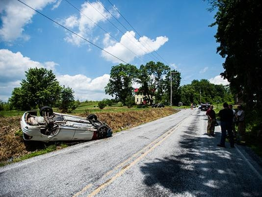 Police investigate a scene involving an overturned vehicle on Old Carlisle Road in Butler Township on May 28. Pennsylvania State Police said they plan to release more information later today.
