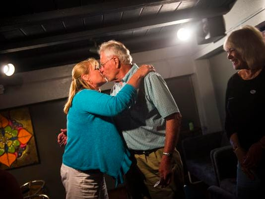 Dan Noble, candidate for Second Ward for Hanover Borough Council, gets a kiss from his daughter, Betsy Rohrbaugh, after hearing results for the May 19 primary. Noble received 84 percent of the votes, unseating Hanover Borough Council's current president, John Gerken.