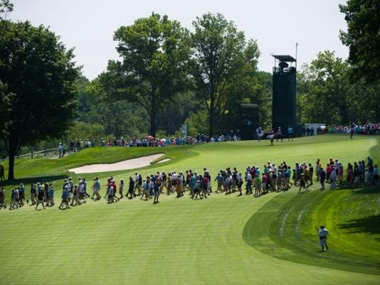 Crowds are seen crossing the 15th fairway during the second round of the U.S. Women's Open on Friday at Lancaster Country Club.