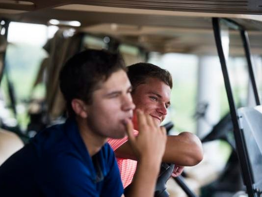 Michael and Justin Gruver compete in Tuesday's first round of the George Barton Match Play tournament at Springwood Golf Club.