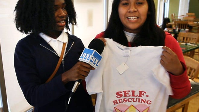 17 middle school students got hands-on business training in a 12 week program sponsored by Interfaith Neighbors and PNC Bank. The Junior Entrepreneur Training Program (JET) had its final meeting at the Kula Cafe in Asbury Park. Micah Wright (left), 12, and Diana Ramos, 14, talk about the T shirts their team made and sold as part of the program. --April 24, 2015-Asbury Park, NJ.-Staff photographer/Bob Bielk/Asbury Park Press