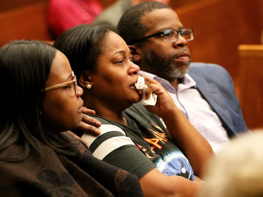 Family members, including Nazerah Bugg's mother, center, wept in court as the medical examiner spoke Wednesday about Nazerah's autopsy results.